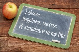 I choose happiness, success and abundance in my life - positive affirmation words on a slate blackboard against red barn wood. Work with Enid De Jesus, Broward counselor for online therapy for women in Florida. You can be finding fulfillment with co-dependency treatment in Florida.