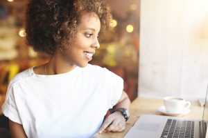 Student Girl Browsing Internet to find anxiety treatment with online therapist, Enid, for online therapy in Florida. You can get help with imposter syndrome, codependency treatment and perfectionism counseling for women in miramar, fl.