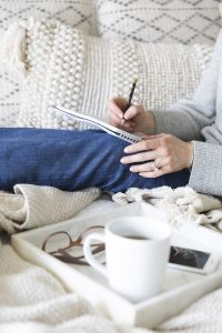 Woman writing in journal about her health anxiety in Miramar, FL. You can start online therapy in Florida for codependency, self-sabotage, imposter syndrome, post-divorce counseling and divorce recovery and more with online counseling for women with anxiety in Miramar, FL. Meet with online therapist in Florida, Enid.