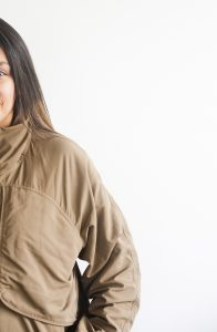 Half of a woman shown standing in a jacket on a white background. You can get online therapy in Florida for codependency and setting boundaries in MIramar, FL from an online therapist.