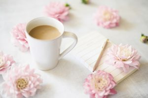 Coffee cup with flowers around and a pad of paper. You can get online therapy in Florida for codependency and setting boundaries in MIramar, FL from an online therapist who specializes in relationship counseling for singles.
