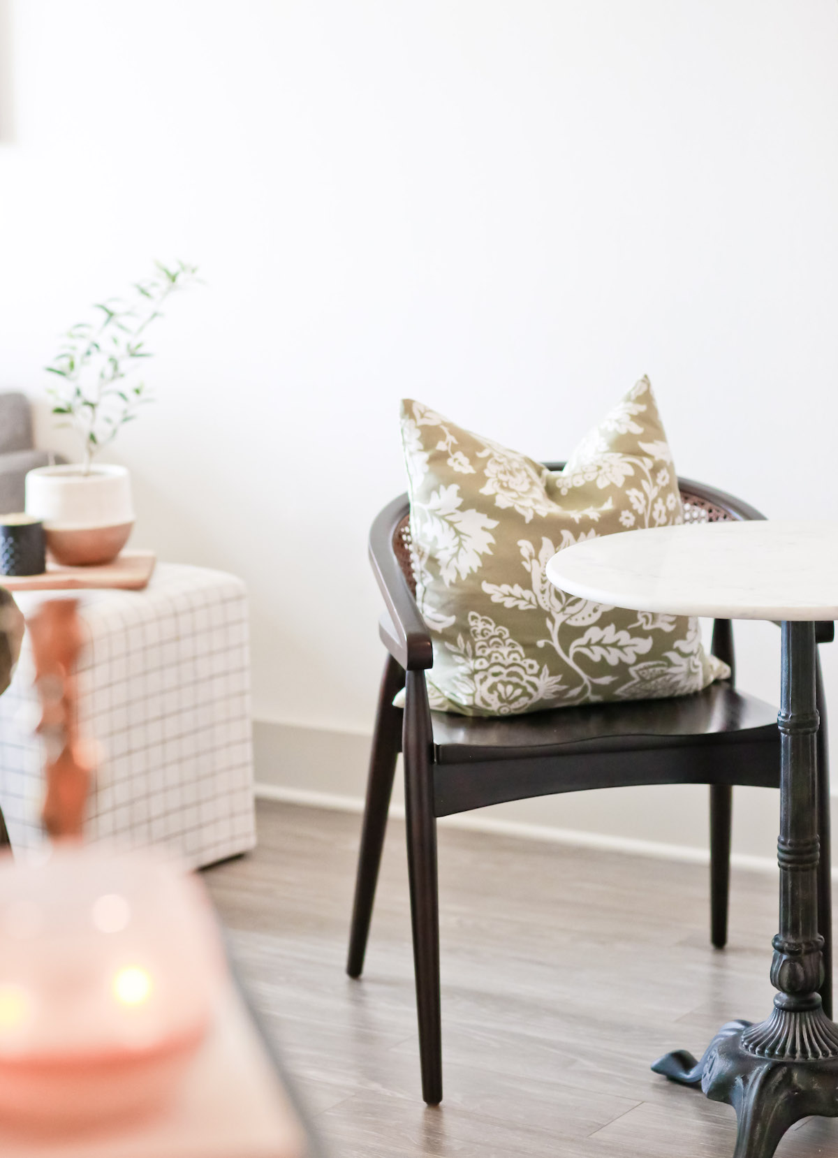 Chair with pillow on it at small table in an elegantly decorated room. Get help navigating healthy boundaries in the workplace with codependency treatment in Miramar, FL for healthy boundaries with online therapy in Florida for women.