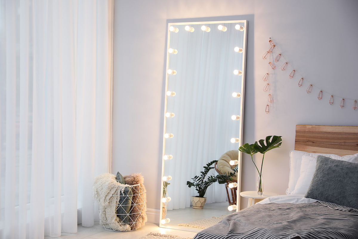 Full length dressing mirror with lamps in stylish bedroom interior. Finding yourself after codependency therapy with a broward counselor can help if you find yourself young and divorced. Divorce recovery can provide support for women in Miramar, FL and beyond.