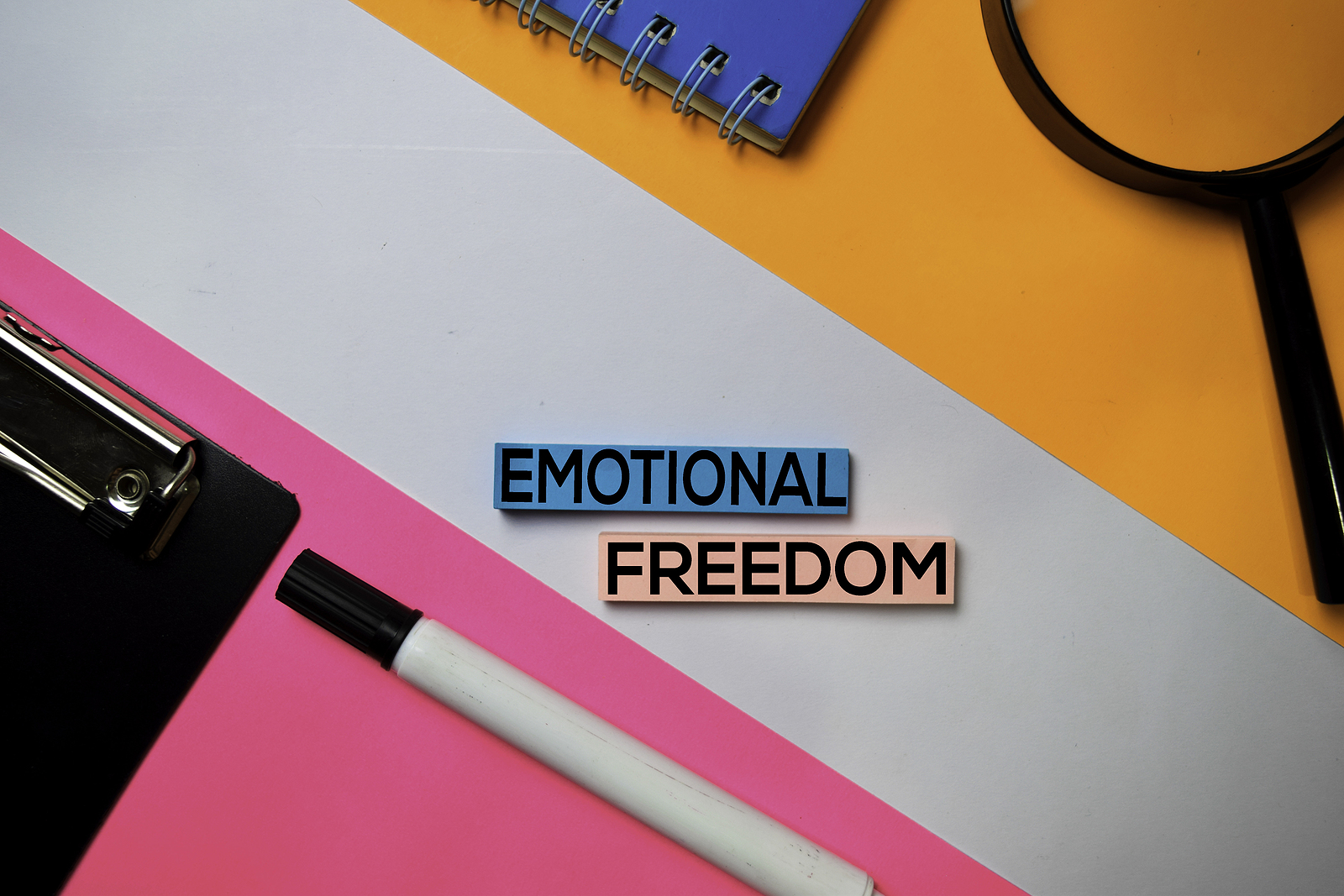 """Notebook and pen with """"Emotional Freedom"""" written. EFT tapping can provide emotional freedom with anxiety treatment in Miramar, FL with a Broward Counselor in online therapy in Florida."""